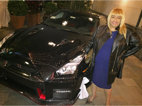 Legendary media personality/author Flo Anthony poses in front of the Nissan GTR