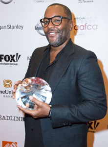 Lee Daniels poses with his AAFCA Awards
