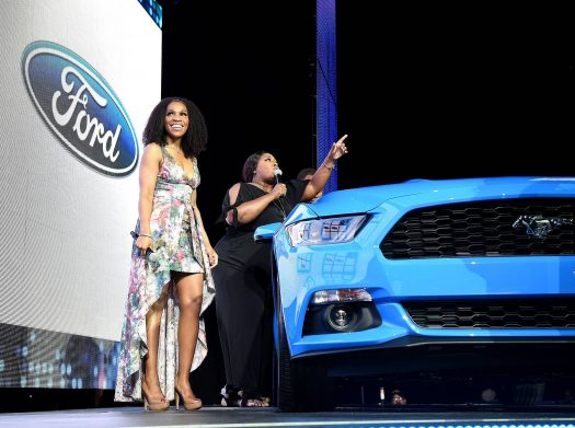 Raj Register & Loni Love on stage with Ford Mustang